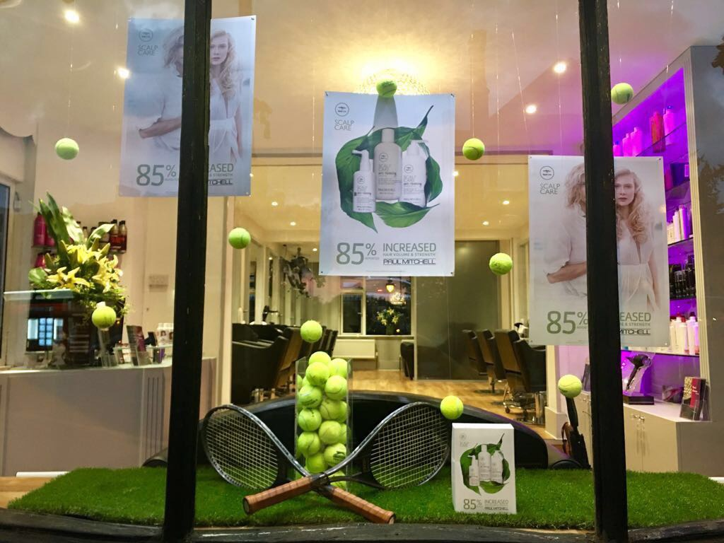 Christmas window displays from paul mitchell for Salon success